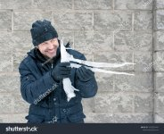 stock-photo-a-man-with-a-huge-icicle-in-the-shape-of-a-gun-1055829410.jpg